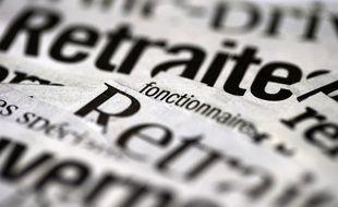 Photo prise le 19 juin 2013 à Paris, de différentes coupures de journaux traitant du sujet de la réforme des retraites.
