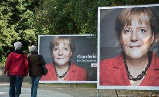 """La chancelière allemande Angela Merkel a beau être considérée comme """"la femme la plus puissante du monde"""", en 33 ans de carrière politique elle n'a pas plus joué la carte féminine que Margaret Thatcher."""