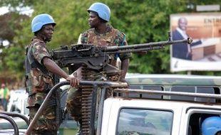 Des Casques Bleus de la Monusco patrouillent dans les rues de Beni, dans l'Est de la RDC, le 23 octobre 2014