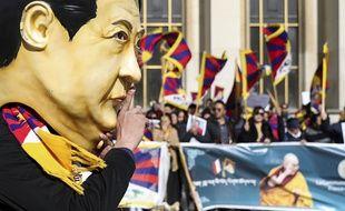 Des manifestants se mobilisent pour les droits de l'homme à Paris, lors de la visite du président chinois Xi Jinping, le 25 mars 2019.