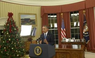Le président américain Barack Obama s'adresse à la Nation depuis le bureau ovale de la Maison blanche à Washington le 6 décembre 2015