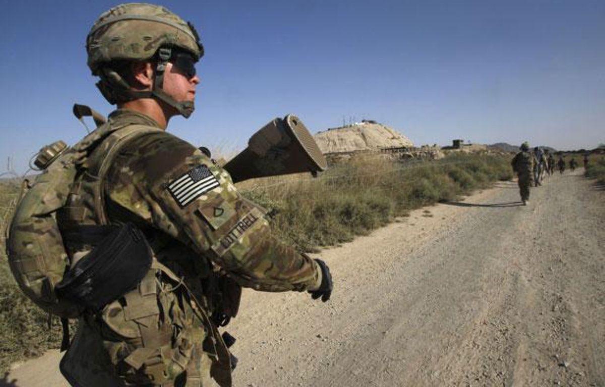 Des soldats de l'armée américaine patrouillent dans le village de Chariagen, dans la province de Kandahar, en Afghanistan, le 22 juin 2011. – no credit