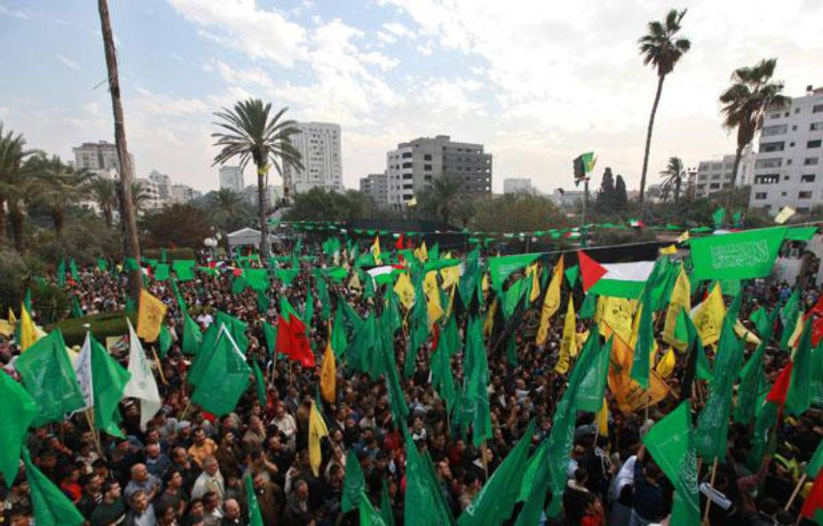 Des Palestiniens fêtent leur «victoire» sur Israël à Gaza, le 22 novembre 2012. – M.SALEM / REUTERS