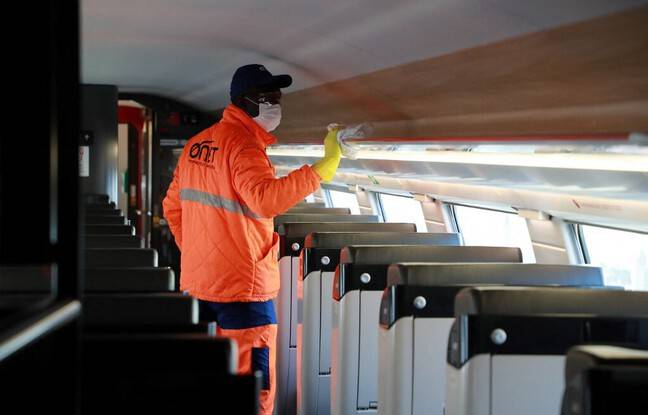 An employee of an SNCF subcontractor cleans a TGV train.