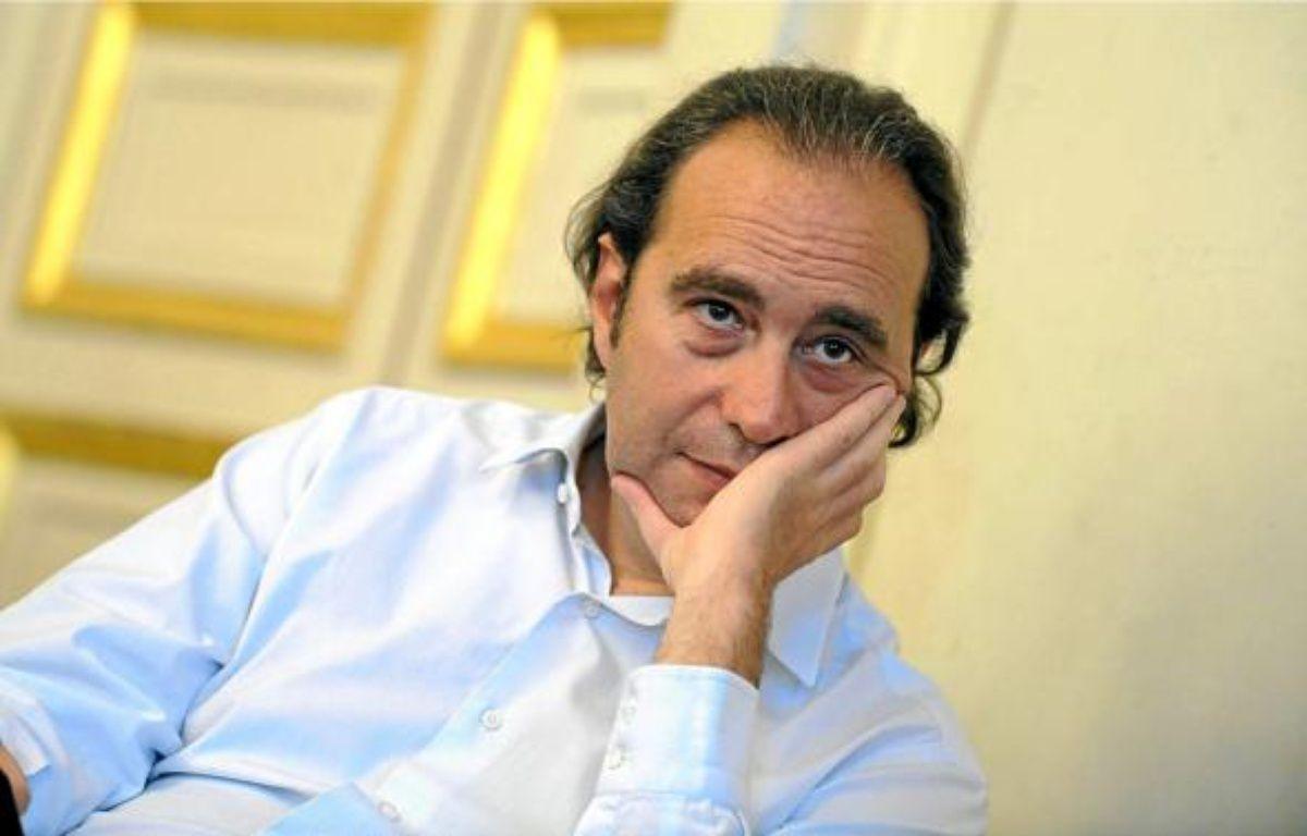 Xavier Niel, le patron de Free, a l'ambition de réduire de moitié la facture mobile des ménages. –  WITT / SIPA