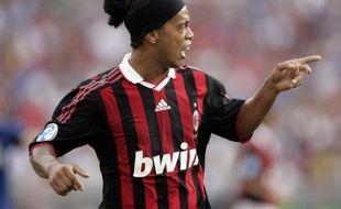 Le joueur du Milan AC Ronaldinho contre l'Inter de Milan à Foxborough (Massachusetts), le 26 juillet 2009.