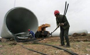 """La Chine a exprimé samedi sa """"grave inquiétude"""" après l'annonce de l'ouverture d'une enquête aux Etats-Unis sur des tours d'éoliennes chinoises soupçonnées d'être subventionnées et vendues à perte sur le marché américain."""