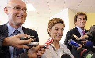 Bernard Laporte, Chantal Jouanno et Max Guazzini, de gauche à droite, le 23 juin 2011, à Paris.
