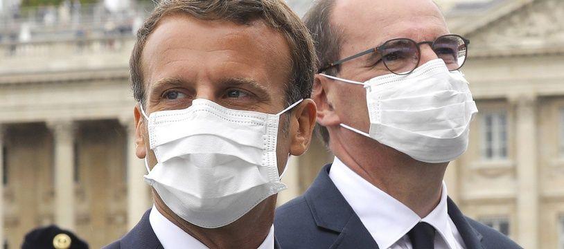 Emmanuel Macron et Jean Castex, masqués, lors des célébrations du 14 juillet 2020