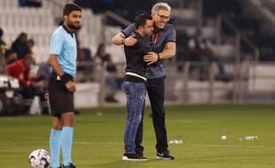Xavi et Laurent Blanc heureux de se retrouver au Qatar.