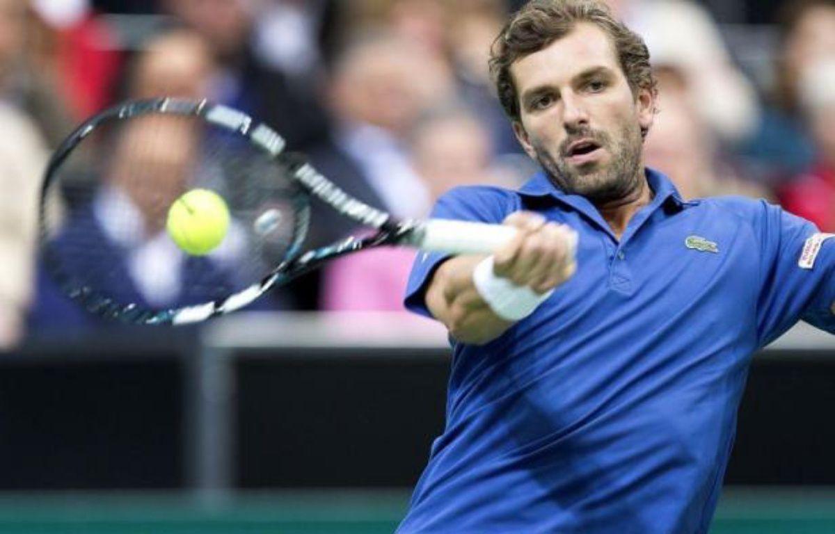 Le Français Julien Benneteau a fait sensation en éliminant dès les quarts de finale du tournoi de Rotterdam l'ancien N.1 mondial et tenant du titre, Roger Federer, vendredi. – Koen Suyk afp.com