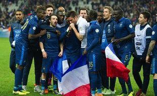 Les joueurs de l'équipe de France de foot lors de leur victoire contre l'Ukraine en barrage de la Coupe du monde le 19 novembre 2013 au Stade de France.