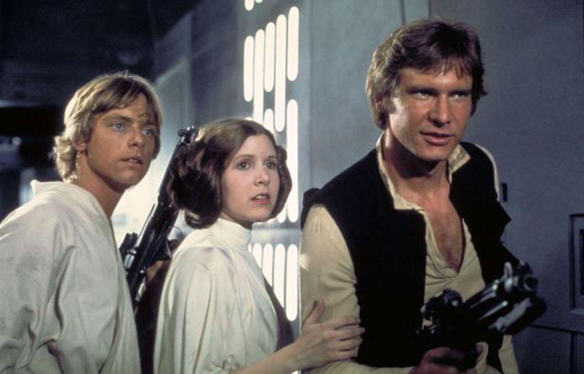 De gauche à droite: Mark Hamill (dans le rôle de Luke Skywalker), Carrie Fisher (Princesse Leia) et Harrison Ford (Han Solo), dans «Star Wars: Episode IV». – Lucasfilm /AP Photo/Sipa