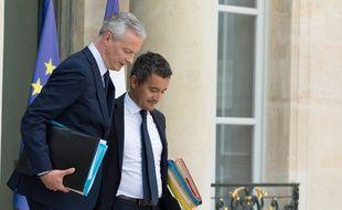 Bruno Le Maire et Gérald Darmanin à la sortie de l'Elysée.