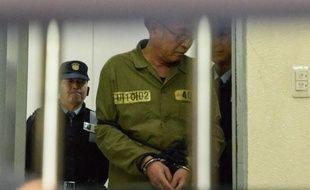 Le capitaine du ferry sud-coréen Lee Jun-Seok (C) arrive le 11 novembre 2014 au palais de justice à Gwangju, en Corée du Sud