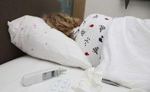 Image d'illustration d'une personne malade de la grippe.