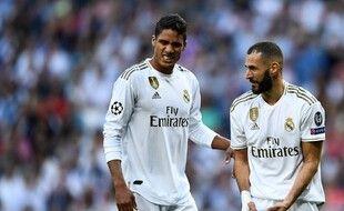 Raphaël Varane et Karim Benzema sous le maillot du Real.