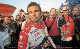 Sébastien Loeb et sa femme Séverine (derrière lui) participent au rallye Epernay-Vins de Champagne, ce week-end. (Archives)