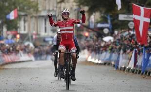 Denmark's Mads Pedersen celebrates winning the men elite race, at the road cycling World Championships in Harrogate, England, Sunday, Sept. 29, 2019.
