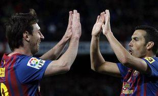 Les Barcelonais Lionel Messi et Pedro, le 10 avril 2012, contre Getafe.