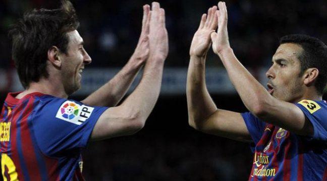 Les Barcelonais Lionel Messi et Pedro, le 10 avril 2012, contre Getafe. – REUTERS/Albert Gea