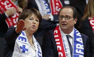Martine Aubry et François Hollande, dans les tribunes du stade Pierre Mauroy le 22 novembre 2014, lors du double de la finale de Coupe Davis opposant la France à la Suisse.