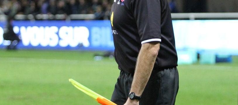 Illustration d'un arbitre de rugby.