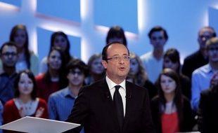 """Le candidat PS à l'Elysée, François Hollande, a réaffirmé vendredi soir qu'""""il n'y a pas eu de tractations"""" avec François Bayrou, mais qu'il verrait """"ce que seront"""" leurs """"relations"""", après le second tour dimanche."""