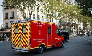 Des pompiers. (Illustration)