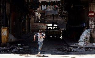 """L'aviation syrienne pilonnait samedi plusieurs quartiers de la ville d'Alep où les violences redoublent d'intensité, le nouveau médiateur international Lakhdar Brahimi se disant """"effrayé"""" par sa difficile mission."""