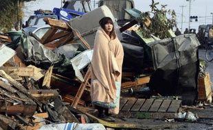 Il y a un an, la photo de Yuko Sugimoto, enveloppée dans une couverture, le regard perdu au milieu des ruines de son quartier où son jeune fils avait disparu, faisait le tour du monde. Aujourd'hui, sa famille est à nouveau réunie mais les cicatrices du tsunami sont loin d'être effacées.