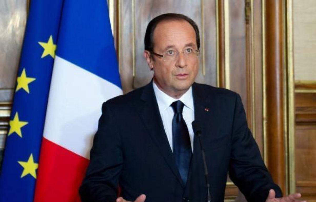 """Le président François Hollande a confirmé samedi soir que le retrait des """"troupes combattantes"""" françaises débutera en juillet et s'achèvera fin 2012. – Bertrand Langlois afp.com"""