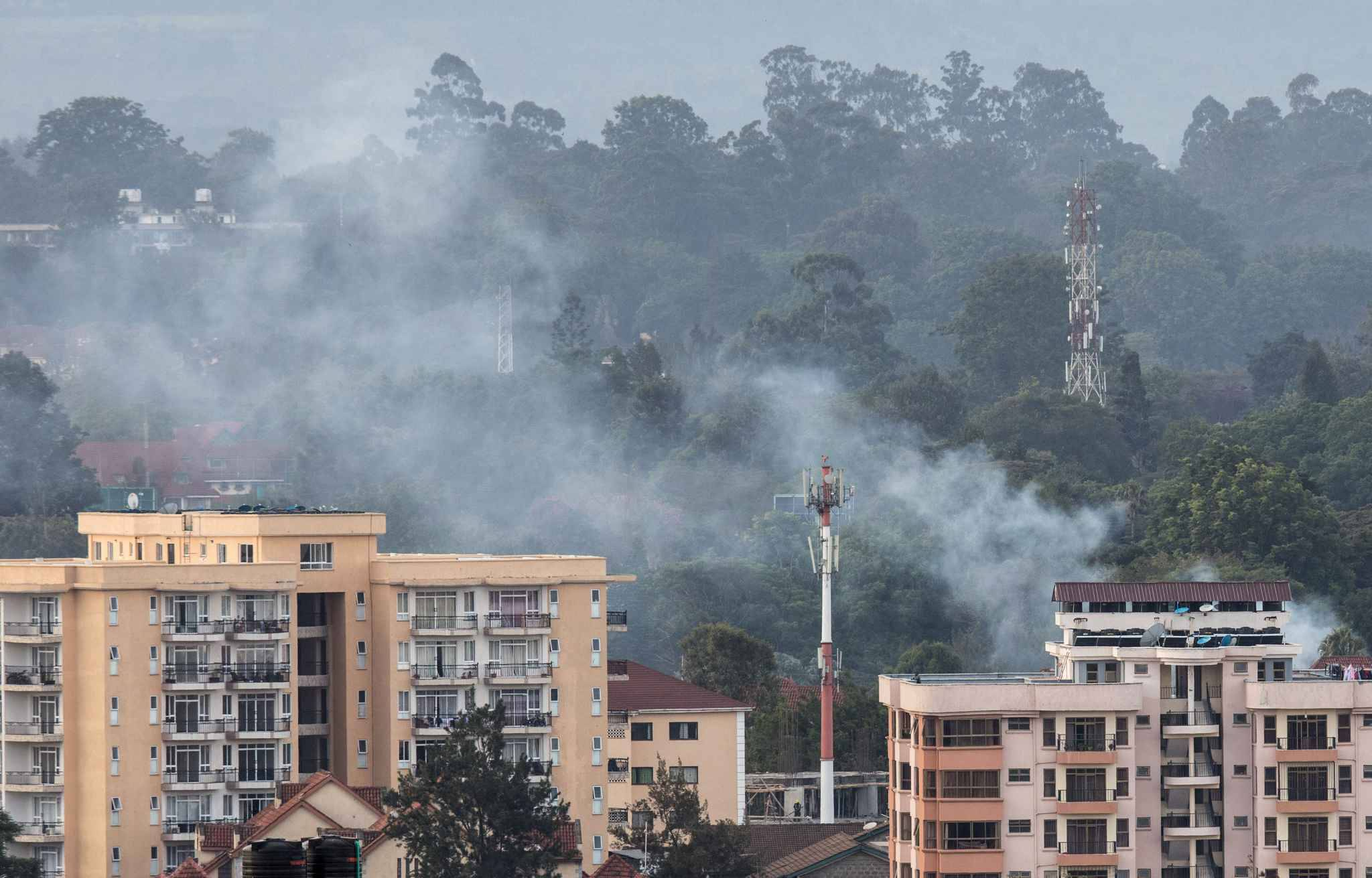 (190115) -- NAIROBI, Jan. 15, 2019 (Xinhua) -- Smoke rises from the blast area after an attack at an upmarket hotel and office complex in Nairobi, Kenya, on Jan. 15, 2019. At least three people have been confirmed dead and several others injured following an attack at an upmarket hotel and office complex in Nairobi on Tuesday, police said.