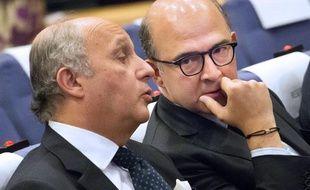 Laurent Fabius et Pierre Moscovici le 15 mai à Bruxelles.