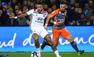 Memphis Depay (OL) et Ruben Aguilar (MHSC) le 22 décembre 2018 à Montpellier.