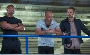 Dwayne Johnson, Vin Diesel et Paul Walker dans Fast & Furious 6.