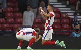 Modric et Perisic, buteurs, savourent leur qualification en huitième de finale.