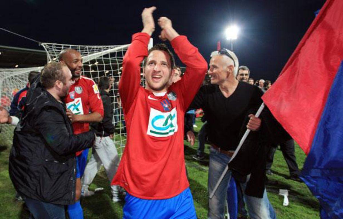 Les joueurs du Gazélec Ajaccio après leur victoire contre Montpellier en Coupe de France, le 21 mars 2012. – P. POCHARD-CASABIANCA / AFP