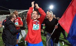 Les joueurs du Gazélec Ajaccio après leur victoire contre Montpellier en Coupe de France, le 21 mars 2012.
