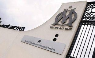 Une perquisition a eu lieu mercredi matin au siège administratif de l'Olympique de Marseille (sud-est) dans le cadre d'un vieux dossier d'extorsion de fonds, a-t-on appris auprès de la direction du célèbre club de football et de source policière.