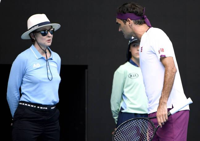 Switzerland's Roger Federer, right, questions a line judge during his quarterfinal against Tennys Sandgren of the U.S. at the Australian Open tennis championship in Melbourne, Australia, Tuesday, Jan. 28, 2020. (AP Photo/Andy Brownbill)/XMEL264/20028213711416//2001280701