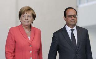 La chancelière allemande Angela Merkel et le président français François lors d'une réunion sur la crise migratoire, le 24 août 2015 à Berlin.