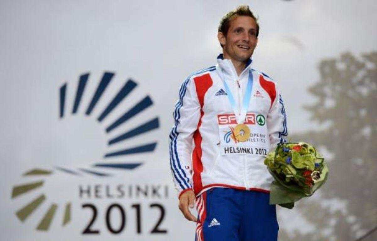 Le perchiste français Renaud Lavillenie a tiré le feu d'artifice de la 5e et dernière journée des Championnats d'Europe d'athlétisme en franchissant 5,97 m, dimanche à Helsinki où l'Allemagne a terminé en tête du tableau des médailles. – Adrian Dennis afp.com