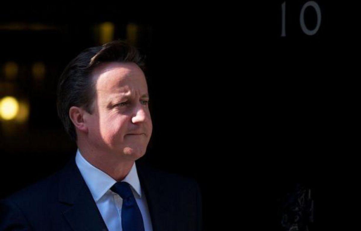 Le Premier ministre britannique David Cameron, son ministre des Finances George Osborne et le gouverneur de la Banque d'Angleterre Mervyn King ont tenu lundi après-midi une réunion consacrée à la crise de la zone euro – Andrew Cowie afp.com