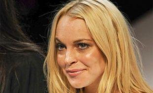 L'actrice et designer Lindsay Lohan à la fin du défilé Ungaro lors de la Fashion week à Paris, le 4 octobre 2009.