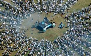Des Uruguyens tentent de réaliser le plus grand barbecue du monde en grillant plus de 12 tonnes de boeuf à Montevideo, le 13 avril 2008.
