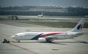Un avion de la Malaysia Airlines le 21 juillet 2014 sur le tarmac de l'aéroport de Sepang à Kuala Lumpur