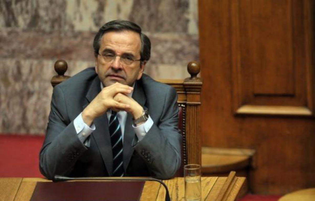 Le nouveau Premier ministre grec Antonis Samaras doit obtenir dimanche soir sans encombre le vote de confiance du Parlement pour sa politique centrée sur les privatisations, juste avant une réunion de l'Eurogroupe lundi à Bruxelles où la Grèce est encore en bonne place au menu. – Louisa Gouliamaki afp.com