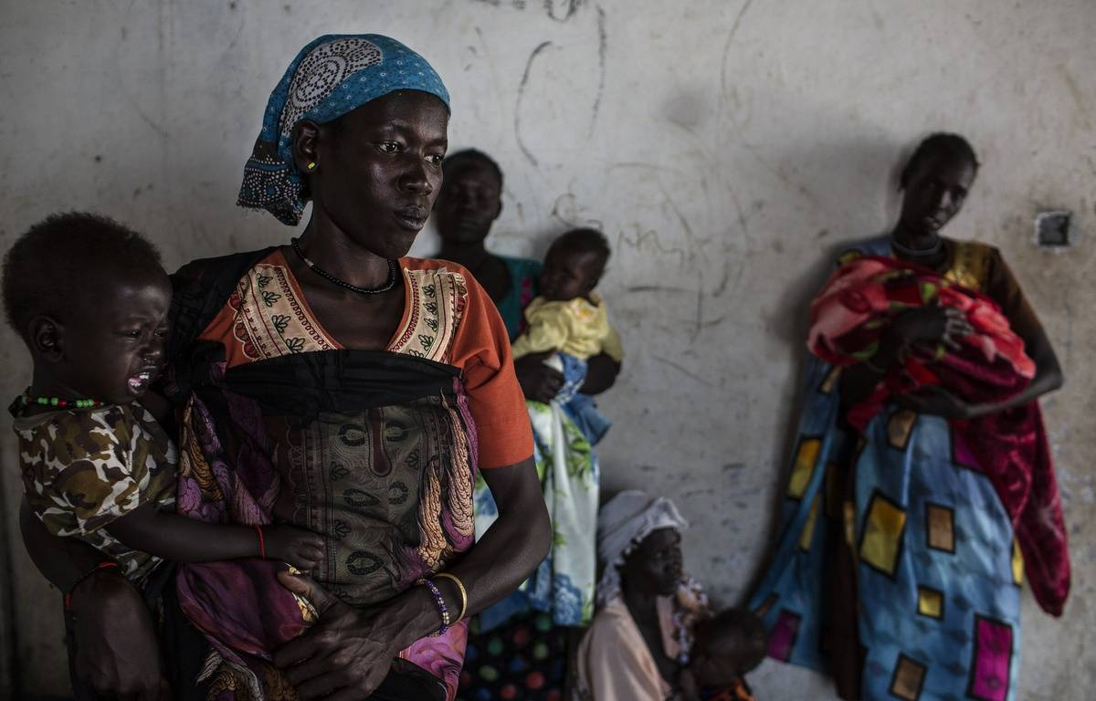 Des femmes arrivent avec leurs enfants dans une clinique mobile au Soudan du Sud, les 8 février 2017.  – Unicef