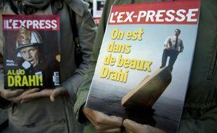Les salariés de L'Express, L'Expansion et L'Etudiant manifestent contre un plan social révélé par Patrick Drahi, le 2 octobre 2015 à Paris